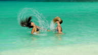 video of women flipping their hair in the Caribbean Sea video