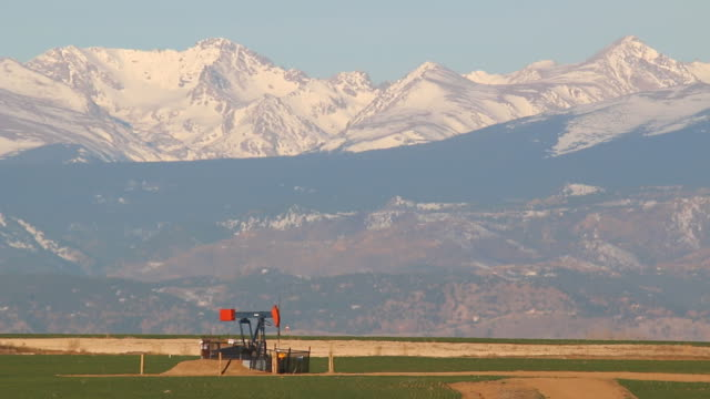 HD video oil derrick and snowy Rocky Mountains Weld County Colorado video