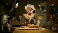 HD Video Old housewife funny cooking in kitchen video