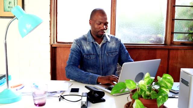 Video portrait African businessman creative studio office video