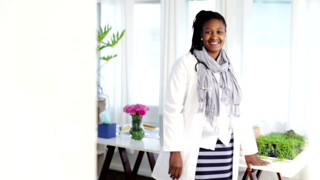Video portrait of proud confident African female doctor video