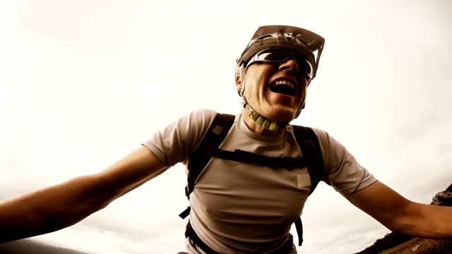 Video selfie of a mountain biker going up the hill video