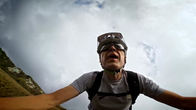 Video selfie of a mountain biker riding before storm video