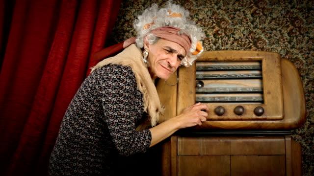 HD video senior grandma with old radio video