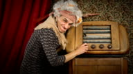 HD video senior grandma with old radio video