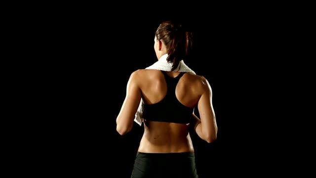 HD video sport girl training dry black background video