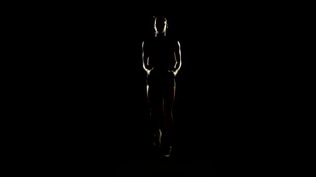 HD video sport girl training exercises step black background video