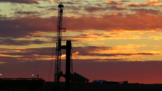 HD video Sunrise oil drill rig flare Weld County Colorado video