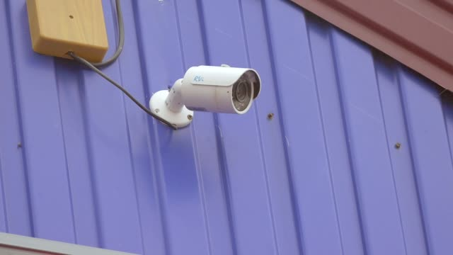 video surveillance camera on a wall video slow motion video