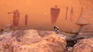 HD video visitor admires Glen Canyon pictographs Utah video