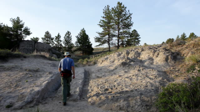 HD video visitor and Oregon Trail wagon ruts Wyoming video