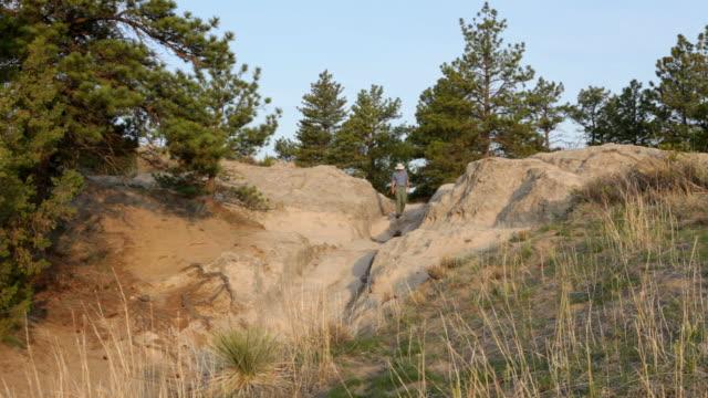 HD video visitor walks Oregon Trail wagon ruts Wyoming video