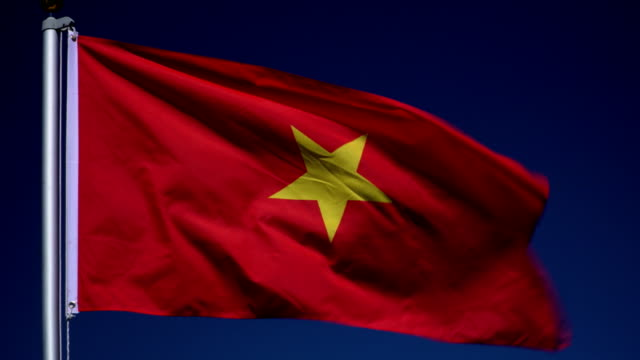 4K: Vietnamese Flag on Flagpole in front of Blue Sky outdoors (Vietnam) video