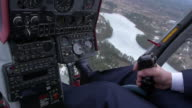View at control system, pilot hold lever of helicopter. Camera inside. Above frozen river, forest video