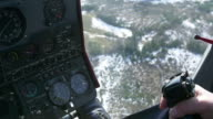 View control system pilot hold lever of helicopter. Camera in pilot cabin. Above forest. Some snow video