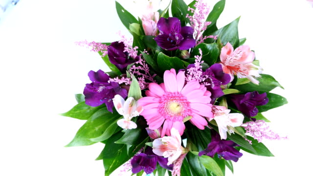 view from above, close-up, Flower bouquet, rotation on white background, floral composition consists of Russus, Alstroemeria, solidago, gerbera video