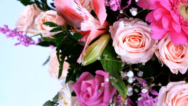 view from above, close-up. Flowers, bouquet, rotation on white background, floral composition consists of gerbera, Eustoma, Rose yana creamy, Alstroemeria, solidago, gypsophila Arachniodis Rose video