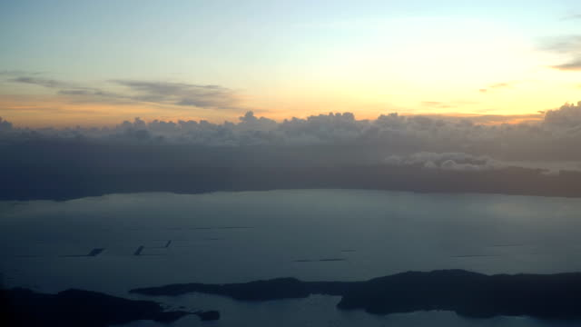 View from an airplane window on the mountains and ocean video