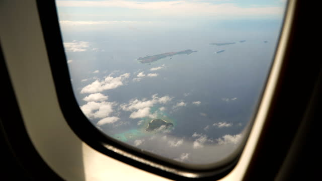 View from an airplane window on the ocean video