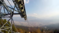 View from cableway cabin at evergreen forest, snow melting in mountains, spring video