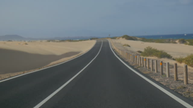 View from car walking fast on a highway in the desert video