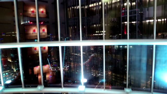 View from glass elevator at night, Dubai, United Arab Emirates. Lift goes down video