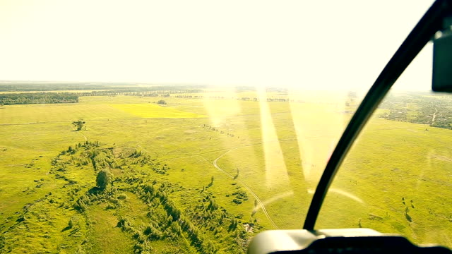 View from helicopter cabin during flight video