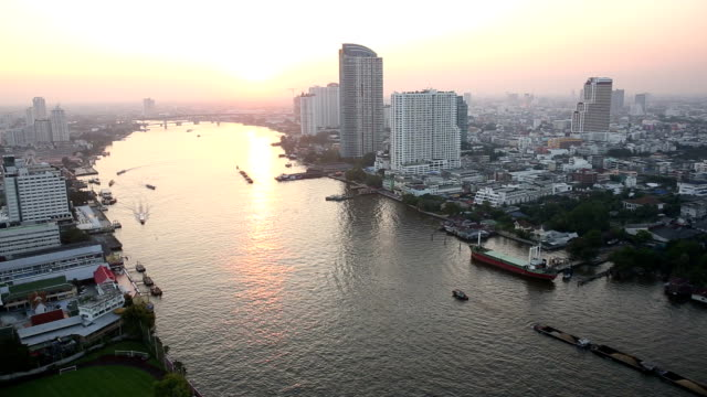 View from hi-rise deck across city skyline, Chao Phraya River video