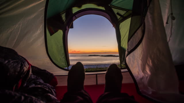View from inside a tent on the sea at sunset video