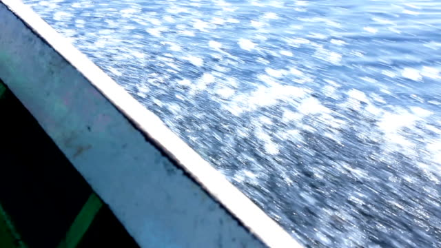 View from side of moving sailing boat video