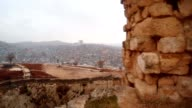 View from Surviving Wall of Urfa Castle on Ditch and Modern City Snow and Rain video