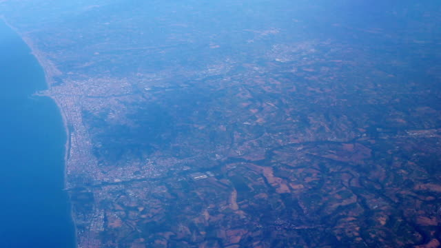 View from the airplane window. Flight over Italy video