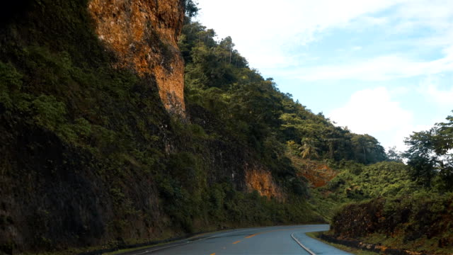 View from the car driving by the asphalt road in Puerto Plata, Dominican Republic video