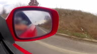 View from the side mirror of a fast sport car video