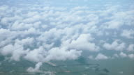 View from the top, above the clouds, rural scene below video