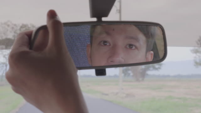 View of a man in the car mirror video