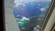 View of a tropical island from airplanes window video