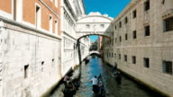 View of a venetian canal in the lagoon, gondoliers, bridge video