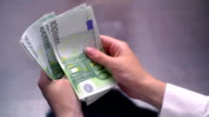 View of a Woman Counting Many Euro 100 Bills video