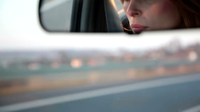 View of a woman in the car mirror video