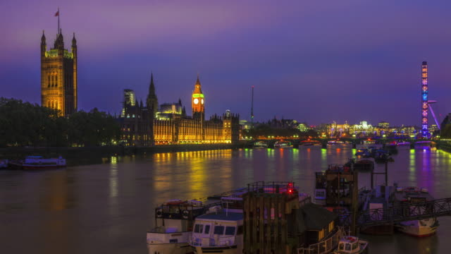View of Big Ben, and the London Eye at night. video