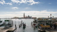 View of church of San Giorgio Maggiore in Venice, Italy with gondolas rocking on water, Time Lapse video
