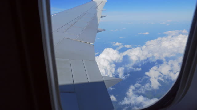 View of clouds and ocean from airplanes window during flight video