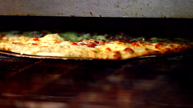 View of delicious pizza baking in oven video