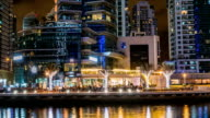 View of Dubai Marina Towers and canal in Dubai night timelapse video