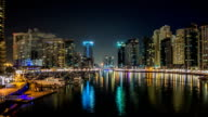 View of Dubai Marina Towers and yahct in Dubai at night timelapse hyperlapse video