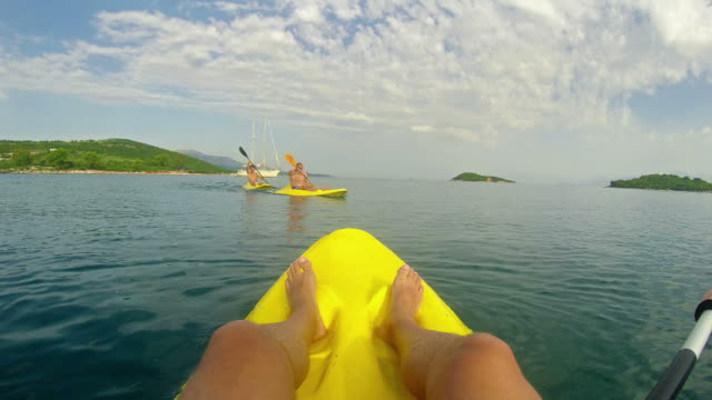 POV view of father and son kayaking on open water video