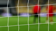 View of goal net with soccer pitch background video