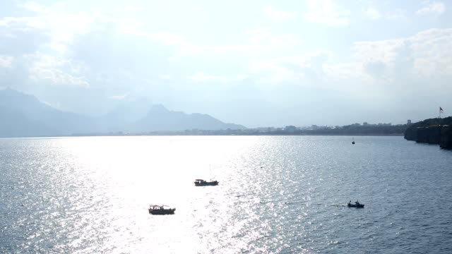 View of harbour, boats and mountains, Antalya video