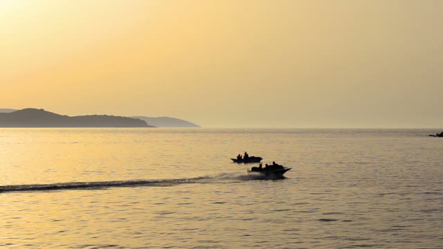 View of luxury boat navigating at full speed at sunset video